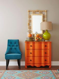 Who said orange painted furniture didn't work? These drawers look amazing and add much needed colour to an otherwise bland looking room.