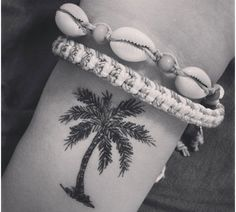 Palm tree tattoo. Probably not on my wrist, but it's cute!