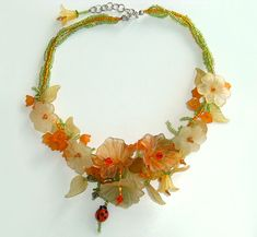 Lucite Flower Jewelry Ideas | lucite and acrylic flowers and leaves, Swarovski crystals, lampwork ...