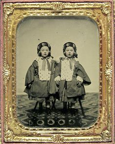 +~+~ Antique Photograph ~+~+   Portrait of twin girls from the Watts family, dressed in identical fur-lined outfits.