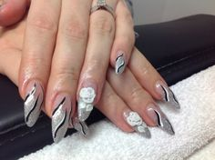 Sculptured nails with glitter polish and acrylic flowers
