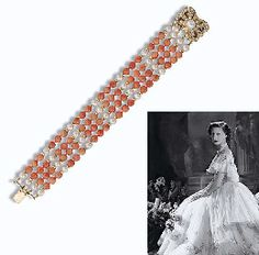 CORAL AND CULTURED PEARL BRACELET  Composed of four strands of coral beads with cultured pearl spacers to the cultured and seed pearl openwork clasp, 19.4 cm. long ~ from the Collection of H.R.H The Princess Margaret, Countess of Snowdon