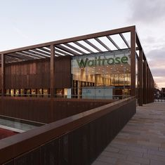 Built by Broadway Malyan in Chester, United Kingdom with date Images by Edmund Sumner. Waitrose is a commercial development located on a key arterial route into Chester City Centre. Supermarket Design, Chester City Centre, Metal Cladding, Steel Frame Construction, Timber Buildings, Solar Shades, Urban Setting, United Kingdom, Metal
