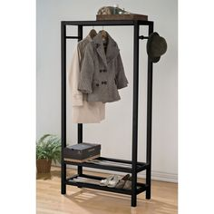 Organize your closet with this wooden garment rack. Featuring two shelves, this rack can hold your shoes for easy access; allowing you to keep your garment neat and tidy.