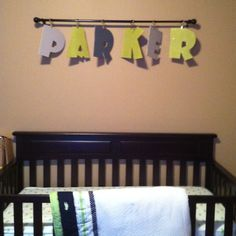 How Zaydens name will be in his room...on a rod hanging down