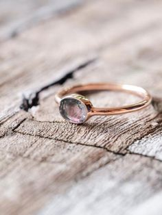 Watermelon Tourmaline Slice Ring in Rose Gold    It also is believed to calm nerves, lead your intuition to new insights and find the right path in your life.