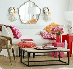 Living Room: Bright Reds Steal The Show In This Moroccan Living Room With Comfy White Fabric Couch Also Pink And Yellow Cushions Plus Unique...
