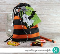 DIY Halloween gift tag by Amy Kolling for Reverse Confetti. Confetti Cuts: Pumpkin Patch, Halloween Bits, Topped Off Tag, and Hang Ups. RC 6x6 paper pad: Fright Night. Halloween favors.