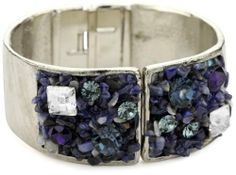"""Sparkling Sage """"Crushed Stone"""" Silver Tone and Blue Hinged Bangle Sparkling Sage. $50.99. This beautiful bangle features twinkling gems amid a bed of crushed sodalite pebbles. Made in USA. The metal is beautifully textured making this piece look truly artisan. Total weight of bracelet is 110 grams. A hinged closure makes for easy on and off. Save 48%!"""