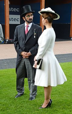 Sheikh Mohammed bin Rashid Al Maktoum (L) and Princess Haya bint Al Hussein attend Derby Day during the Investec Derby Festival, celebrating The Queen's 90th Birthday, at Epsom Downs Racecourse on June 4, 2016 in London, England.