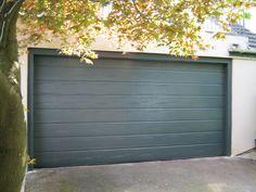 #Hormann M-Ribbed Sectional Garage Door in Woodgrain Anthracite Grey. #GarageDoor