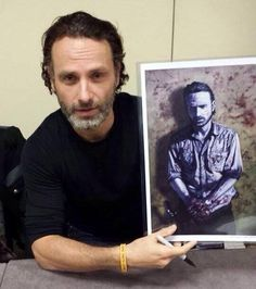 Andrew Lincoln Showing Off His Rick Grimes Art