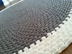 Crochet rug made of high quality fabric yarn (t-shirt yarn). Colors: Grey melange and off white. The rug is made of cotton fabric, its very soft and