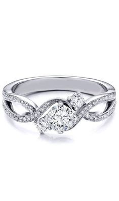 I've never been a big jewelry or diamond girl, but this Three Stone Infinity Diamond Engagement Ring... Now THAT is a beautiful ring.