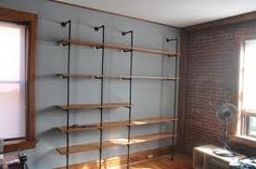 Break up the long hanging racks with shelving like this on one side of the shop.
