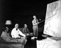 Admiral Nimitz, commander of eastern Pacific, briefs President Roosevelt, Admiral Leahy, and General MacArthur, commander of the western Pacific, on operations advancing toward Japan DOD