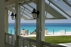 Bermuda shutters on porch.  I thought of doing this with screened panels...