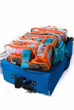The Complete Bundle in Orange. Eight packing cubes, two shoe bags, one laundry bag, folding boards, and a duffle bag for packing an organized suitcase!