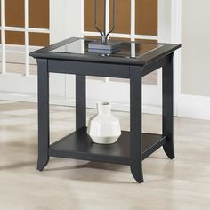 Dartmouth End Table by TECH CRAFT. $204.74. WHERC2424B Features: -Material: Solid birch and wood veneers.-Beautiful beveled glass and elegant.-Extra shelf for added utility.-Accommodate most decors. Warranty: -Warranty: 1 Year.