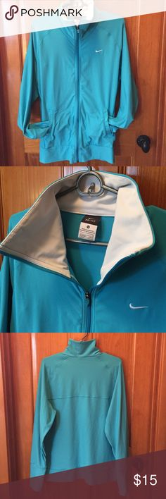 Nike Dri-Fit Warmup Jacket Comfy warm up or athleisure wear jacket in turquoise blue. Full zip with two hand pockets and a collar. Sleeves are long enough to have thumbholes, keeping your hands warm on chilly outings. Only worn a few times. High quality stretchy fabric (92% polyester, 8% spandex). Nike Jackets & Coats