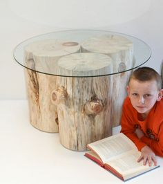 This guy makes custom tree bases if you are still interested in this option. Coffee Table Tree Stump Trio Natural Stumps Stools Set of Three. $525.00, via Etsy.