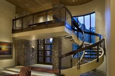 upstairs hallway, spiral stair case and brown/white color contrast, stone walls  {Desert Highlands}