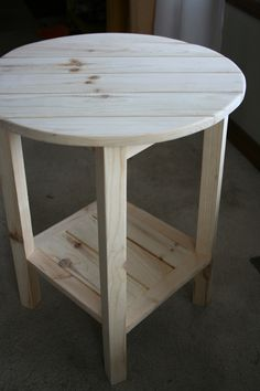 round side table maybe made from old coffe table and end table wood