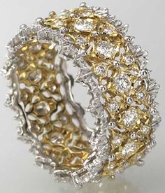 This white gold, yellow gold, and diamond Buccellati ring plays an important part in Beth Bernstein's memoir, My Charmed Life.  Via Diamonds in the Library.