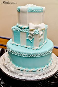 Tiffany Blue wedding cake with both round and square tiers and a bow
