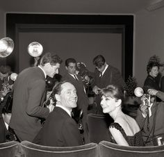 Photographers surround Ferrer and Hepburn at the premiere of Breakfast at Tiffany's at Cinema Fiammetta in 1961.