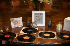 Guests sign vinyl records with silver sharpies as guest book   Gilbert Rivera Photography   villasiena.cc