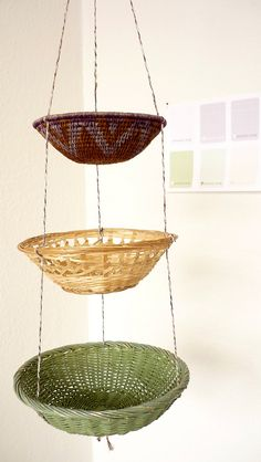 Baskets strung together and hung - brilliantly simple