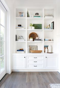 "Inspiration: Soft and Warm Love the shaker style doors; note the middle ""third"" is larger than the two side panels; think squares.Love the shaker style doors; note the middle ""third"" is larger than the two side panels; think squares. Bookshelf Styling, Bookshelves Built In, Bookcases, Built In Shelves Living Room, Bookshelf Ideas, Bookshelf Design, Custom Bookshelves, Modern Bookshelf, Bookshelves In Living Room"