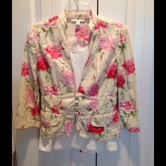 Banana Republic floral jacket size 4 Really cute linen/cotton blend beige and pink rose floral jacket!  Pretty details include covered buttons, pocket flaps, double stitching, and very cute ribbon tie in back! Perfect over a tank dress or top...or keep it casual with jeans and flats!! Banana Republic Jackets & Coats Blazers