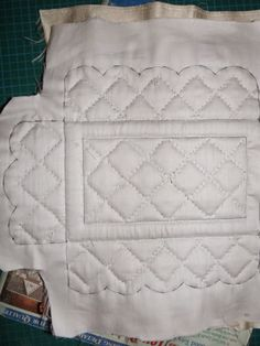 Layered hand stitched quilt using cotton fabric on the bottom with pattern pen marks, then foam and silk fabric top    Late Victorian English Manor Dollhouse:Countess's Bedroom.  Also curtain details.