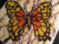 Latch hook rugs- my mom used to make these...I had a holly hobby one and I think we had one like this...