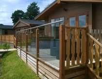 Caravan park decking balustrade system with stainless steel fittings and timber posts. Patio Balustrade Ideas, Decking Glass Balustrade, Balustrade Design, Glass Railing, Balcony Railing, Deck Railings, Timber Posts, Timber Deck, Sloped Garden