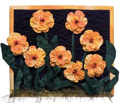 Marigolds from More Fabulous Flower Quilts - The website promoting the book includes a how-to for making these marigolds and other ruched flowers. See http://blog.shopmartingale.com/quilting-sewing/flower-quilts-3-ways-ruched-flowers-how-to
