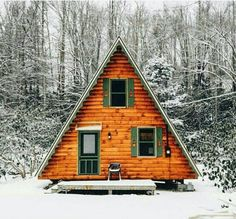 A frame cabin in snowy woods