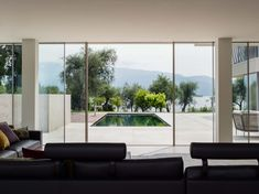 The villa is designed to live in symbiosis with nature without any separation. Two volumes of glass between the slope and the water of the lake surrounded by open spaces covered with white stone and wood that are creating a play of light and shadow with the large frameless sliding Sky-Frame windows that give way to the majestic panorama and outdoor life in the beautiful park creating a unique environment that blends with the outside.  Photography: Marcello Mariana Beautiful Park, Open Spaces, White Stone, Light And Shadow, Outdoor Life, The Outsiders, Environment, Villa, Italy