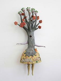 These ceramic sculptures by American artist Kathy Ruttenberg explores nature and the built environment in fired clay like an elaborate children's book, an enchanted tale of dogs, birds, goats, rabbits, and deers.