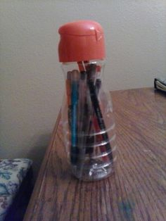 Clear coffee creamer bottle with pens and pencils