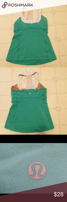 Lululemon Workout Tank Size M Cute design. Gently worn. Size Medium. Good condition no stains or tears. Color is most accurate in last photo. More of a turquoise light blue. lululemon athletica Tops Tank Tops