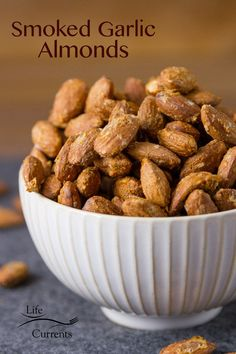 """These Smoked Garlic Almonds are the bomb tailgating snack! And no smoker needed! Like """"make a batch, sit down with a beer and these and watch the game while noshing away"""" snack! Savory Snacks, Easy Snacks, Healthy Snacks, Healthy Recipes, Eating Healthy, Keto Recipes, Thanksgiving Recipes, Holiday Recipes, Thanksgiving Appetizers"""