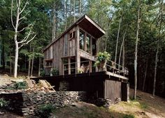 Need to get away from the world? You got it. This private, rustic bungalow located in Sullivan County, New York is handcrafted from 100-year-old reclaimed barn wood and, with no water or electricity, will let you live totally off the grid.