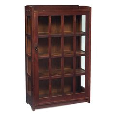 "Gustav Stickley (1858-1942) - China Cabinet/Bookcase. Quartersawn Oak with Glass Door Panels and Copper Hardware. Circa 1900. 58"" x 35-1/2"" x 13""."