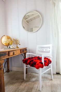 Here's how to make a DIY pom-pom chair, courtesy of Mr. Kate