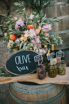 We love the idea of an olive bar on a wedding buffet! Such a simple, yet crowd-pleasing finger food. Check out more ideas from this Tuscan vineyard wedding and more on 100 Layer Cake!