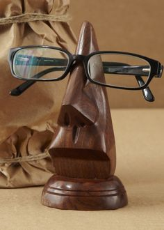 This wooden face sculpture holds your dad's glasses: http://www.womenshealthmag.com/life/gifts-for-dad-2013 #FathersDay #gifts