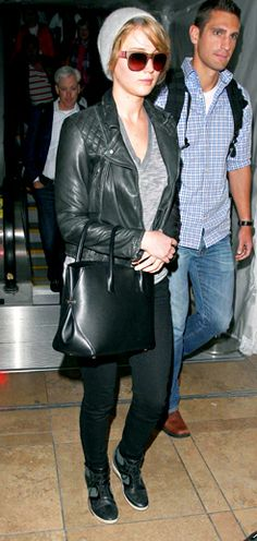 Jennifer-The Hunger Games beauty wore All Saints' leather biker jacket with jeans